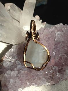 Soothing Fluorite Pendant. Stay calm, cool, and collected with this clean fluorite pendent. This wrap enhances the stone keeping the wire to a minimal showing off the beauty of the natural frosted face. The light aqua coloring and natural internal fractures make this piece extraordinary and unique. See it in video: https://www.youtube.com/watch?v=niYQkJ6CK18  #handmade #reikijewelry #fluorite #fireandwire #yoga #wirewrap