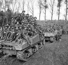 Soldiers of 51st Highland Division are carried into battle aboard Sherman tanks near Uldenhout, in the Netherlands, 29 October, 1944.