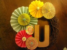 My daughter's spring wreath. She just needs to modge podge some cute paper on the letter.