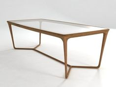 Table with structure and central cross base made entirely in solid American walnut. Top in wood or visarm glass, transparent, sandblasted, smoked or bronzed.