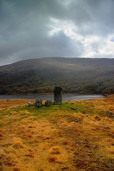 Uragh stone circle on a hilltop overlooking Uragh Lough. A Neolithic five stone circle with a huge 3.5m monolith in the ancient forest of Gleninchiquin. Tuosist, County Kerry, IRELAND.