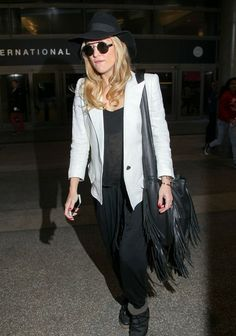 'Good People' actress Kate Hudson arriving on a flight at LAX airport in Los Angeles, California on January 17, 2014.