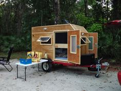 Camping trailer small woody camper.  Frugal Way camping with mini camper trailer creation 920lbs 8x4ft.   Has Air Conditioner, electricity 120 VAC and 12VDC.   Fits inside the garage and you can physically move it yourself.    Picture taken at Faver-Dykes FL State Park.