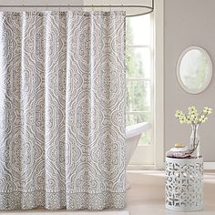 An oversized medallion print in a warm light grey makes the Intelligent Design Nessa Shower Curtain a versatile choice. Pair this chic yet easy-care curtain with the colors of your choice. A contrast print at the hem provides a finished look.