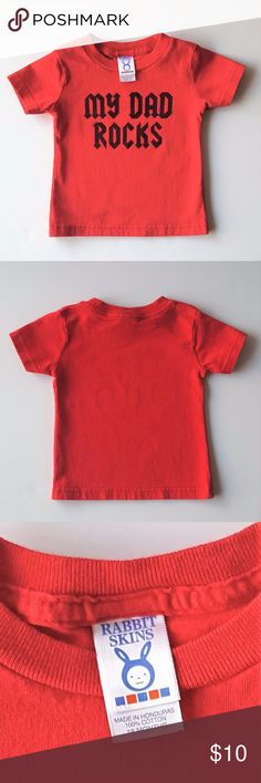 "Rabbit Skins ""My Dad Rocks"" Tee - Size 18 Months Rabbit Skins red t-shirt with ""My Dad Rocks"" printed on the front in black (in an appropriate rock band style font) - Size 18 Months -  100% Cotton - EUC (Excellent Used Condition - No rips, stains or odors - Minimal wash and wear) - Perfect tee that's sure to add  some color and sass to any little one's wardrobe!  My daughter wore it with a long, pink tutu for a half pretty princess/half rocker chick vibe!!! Rabbit Skins Shirts & Tops Tees…"