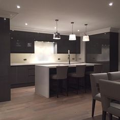 """Kitchen in our Esher project almost finished. Love the contrast of the high gloss grey lacquer against the rustic grade taupe grey oak flooring"""