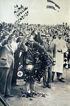 """Tazio Nuvolari won German Grand Prix of 1935 with """"Alfa Romeo"""" against at least other eight (8) Auto Union and Mercedes cars (much more advanced cars). Note the Trophy on Tazio's hands..."""