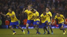 Gunners celebrate their victory on penalty shootout against West Bromwich Albion in Capital One Cup