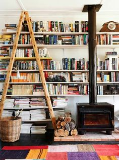Why not stand a ladder up for the top shelves. Neat decoration!