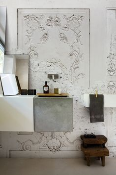 Bathroom with ornate plaster work and a concrete modern sink - Combining the old and new / modern and traditional
