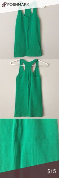 Nikibiki Green Tank Super stretchy and forgiving Green Nikibiki Tank. Great for everyday or athletic wear. Some  pilling see picture! Nikibiki Tops Tank Tops