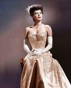 Ava Gardner 50s pink beaded gown color photo print ad model movie star strapless long dress gloves 40s feather satin