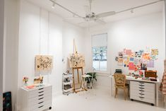 Before & After: A Drab Studio Becomes A Fresh Backdrop for Vibrant Floral Artwork – Design*Sponge Art Studio At Home, Home Art, Flat Files, Floral Chair, Studio Kitchen, Floral Artwork, White Shelves, Space Crafts, Window Coverings