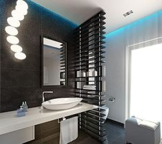 Modern bathroom with recessed lighting and a stylish privacy screen