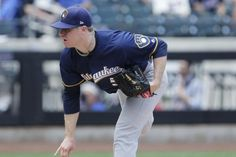 CINCINNATI — The first-place Milwaukee Brewers lost one of their most consistent starting pitchers when right-hander Chase Anderson left Wednesday night's game in Cincinnati after pitching just one inning with what the team called a left oblique strain.  Anderson needed just eight... - #Af, #Anderson, #Brewers, #Chase, #Leaves, #Milwaukee, #MLB, #Pitcher, #TopStories