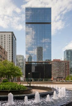 Optima Chicago Center's exterior building aesthetics evolve from an expression of the functional spaces withih - transparent glass at the street level, black translucent glass at the parking level and energy efficeint silver metallic glass on the residential floors.