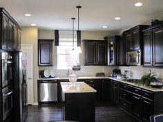 kitchen idea. Gray walls dark cabinets
