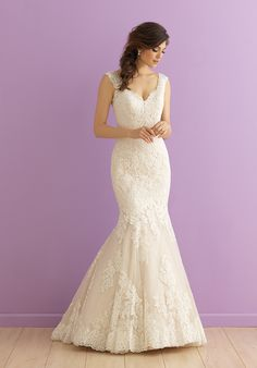 This lace gown features a gently scooped back and chapel length train.