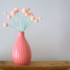 Peach pom pom flower blossoms.  Apricot wool balls.  Woolly balls, billy buttons.  Felted flowers.  Cottage shabby chic.  Turquoise stems.