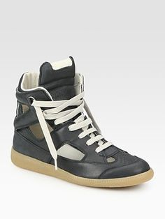 by Maison Martin Margiela  Cutout High Top Sneakers  These are great looking but dont wear em like a lame ass keep the tongue tucked inside your jeans. please. with shorts i fold the tongue in half and tie it tight. dont wear em with the laces hanging out, its not cool.