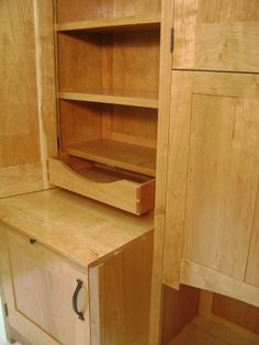 This side hutch features plenty of storage courtesy of adjustable shelves and a low-profile pull-out drawer.