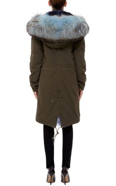 This dark green cotton canvas **Mr & Mrs Italy** parka features a utilitarian style with a denim blue racoon trimmed hood and a tonal fox fur lining.