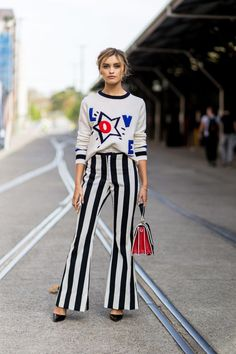 - Bold-stripe pants play well with a graphic sweater.