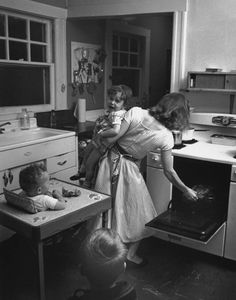 Looks like our kitchen in the 50's I had that exact highchair it was a Baby Butler and lasted through 13 grandkids