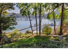 See MLS details for 15123 NE Anna Vera Lane, Bainbridge Island, WA 98110, MLS# 1037250. Spectacular Craftsman Home on Port Madison Bay w/a picturesque setting. Sun-drenched low bank waterfront w/rock wall terraced gardens. Exceptional sought after 60' Dock w/Deep Water Moorage (built 2009) & shared boathouse. Gracious open floor plan accentuates the Port Madison Views. Superb finishes throughout-polished Brazilian cherry floors, granite counters, stainless appliances. ...
