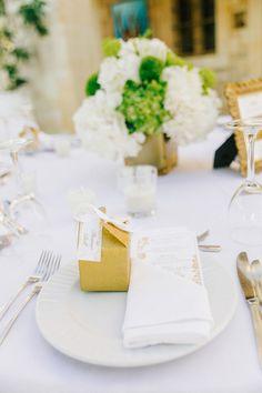 Elegant place setting idea - white napkins with white + gold menu card and gold favor box {HannaMonika Wedding Photography}