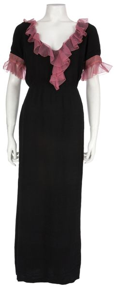 """Carole Lombard's 1932 Screen-Worn Dress from """"No Man of Her Own."""" A rare remnant from Lombard's short but glorious career, this black crepe dress with sheer pink accents has an internal Paramount Atelier tag listing Lombard's handwritten last name on the label. This label traces the piece back to Travis Banton and the few years he had his own atelier within the Studio at Paramount."""