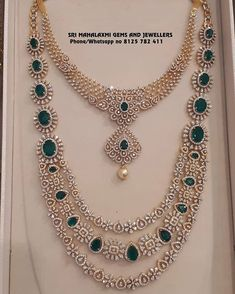 Stunning gold necklace and long haaram studded with diamonds and emeralds.Visit for latest designs of IGI certified finest quality Diamond jewellery. Contact no 8125 782 16 December 2018 Indian Wedding Jewelry, Bridal Jewelry, Wedding Jewelry Sets, Diamond Necklace Set, Diamond Choker, Dimond Necklace, Diamond Stud, Emerald Diamond, Diamond Rings