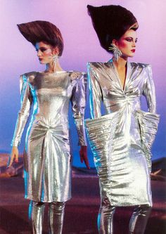 Thierry Mugler by Peter Knapp, 1979. 70s 80s fashion style designer silver lame lurex dress 40s inspiration style draping padded shoulders color photo print ad models magazine