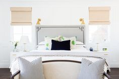 Gray headboard with brass sconces || Studio McGee