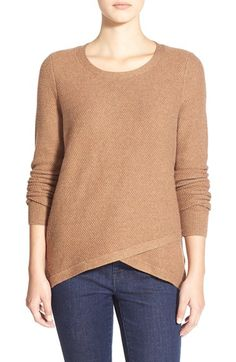 I like the color and fit of this sweater, and the layered look at the bottom.