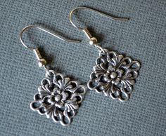 Antiqued Silver Flowers in Diamonds . Earrings by MerelaniDesigns, $0.20