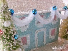 garland and blue ornaments/ pink windows/ ornaments on trees- RRM