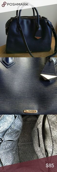 "Rebecca Minkoff Navy Blur Satchel Beautiful navy blue carry all satchel. Great for school and work. Great detail and interior compartments for cell phone, lipstick etc. Carry it using the shoulder strap or handles. Fits 13"" MacBook air and notebooks. I love this bag but don't use it enough anymore. In good condition! Rebecca Minkoff Bags Satchels"
