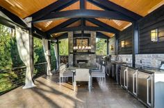 Lovely outdoor patio with tile flooring. Outdoor kitchen and candle chandelier.