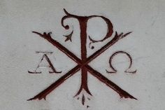 "Used to want a tattoo with ""alpha and omega"". This says ""Chi Rho"" (Jesus Christ- The X and P letters) and ""Alpha Omega"". Pretty sweet, but I don't think I""m brave enough for needles, or anything permanent!:"