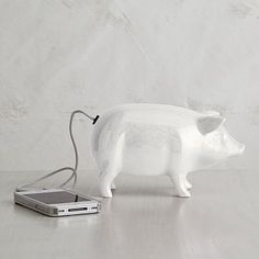 This little piggy can play. More than just a sweet sculpture, this Ceramic Pig Speaker works with any mp3 player.