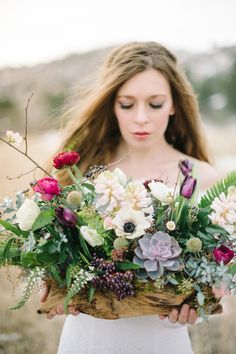 Succulent, fern, ranunculus, and anemone centerpiece | Carrie King Photographer | see more on: http://burnettsboards.com/2015/02/winter-bride/
