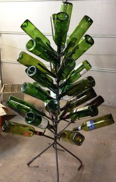 Wine Bottle or Beer Bottle Trees have the look by theperidotwindow