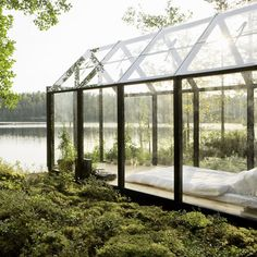 Glass bedroom by the waterside on a remote Finnish island.