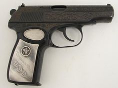 Russian Makarov 9mm Makarov caliber pistol. Ultra rare factory engraved presentation model commemorating 70 years of the Russian revolution. The gun has extensive engraving coverage and fancy silver inlaid grips and is cased with accessories. These guns were given to high ranking Soviet officials and are almost impossible to find here