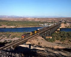 https://flic.kr/p/C5QP6a   Enter California...   Westbound Santa Fe (oops, sorry..BNSF) rolls across the Colorado River from Topock, Arizona into California on a most toasty October 1996 afternoon.  Pentax 6x7 on Kodachrome 64 Pro.
