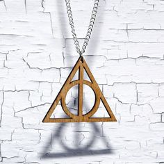 would it be redundant to have two deathly hallows symbols on me at all times? don't care.