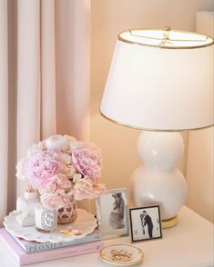 (C) The Pink Dream - Designs By Ceres | Bedside Table decor | Photoframes | #aesthetic #bedside #bedsidelamp #candles #photos #newhomedecor #homedecorideas #pastel #whiteaesthetics #wittyvows Bedside Table Styling, Bedside Table Decor, Bedside Lamp, Corner Table, Cozy Corner, House Shifting, Night Lamps, Wall Spaces, New Room