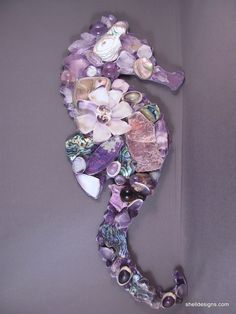 Lavender Seahorse made with amethyst crystals, glass gems and abalone shell. Gorgeous