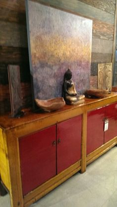 """Another Bathurst Renovation Sneak Peak. This brand new orange & red poplar buffet from 1900s Mongolia has two cabinets 36"""" H, 76"""" W, 17.5 D -$1650. Ontop the buffet is painted buddha casted in bronze -$295, two hand carved bowls -$40 each, and two hand carved Chinese panels that were once the inlays on different -$125 each. Back with an canvas splattered with cool acrylic tones 40"""" SQ -$395"""